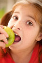 Cute little girl eating an apple portrait of Royalty Free Stock Photography