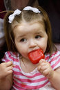 Cute little Girl eating Ice Cream Stock Photo