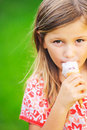Cute little girl eating ice cream happy cone looking Royalty Free Stock Photo
