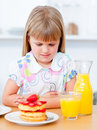 Cute little girl eating waffles with strawberries Royalty Free Stock Photography