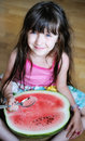 Cute little girl eating watermelon Royalty Free Stock Photography