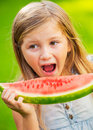 Cute little girl eating watermelon big mouth Stock Images