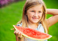 Cute little girl eating watermelon fruit Stock Photos