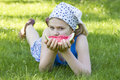 Cute little girl eating watermelon on the grass Stock Image