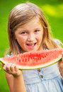 Cute little girl eating watermelon looking at the focus Stock Images