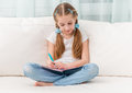 Cute little girl filling in a friends album Royalty Free Stock Photo