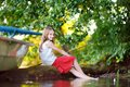 Cute little girl fishing with a fishing rod by a river Royalty Free Stock Photo