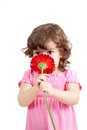 Cute little girl with flower gift Stock Photo