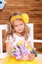 Cute little girl with flowers and alive chicken Royalty Free Stock Photo