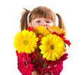 Cute little girl with gerbera flowers bouquet a Royalty Free Stock Photos
