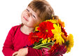 Cute little girl with gerbera flowers bouquet a Royalty Free Stock Image