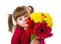 Cute little girl with gerbera flowers bouquet Royalty Free Stock Photo