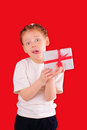 Cute little girl with a gift for Valentine's Day Royalty Free Stock Photo