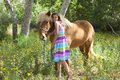 Cute Little Girl Giving her Pony a Snuggle Royalty Free Stock Photo