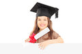 Cute little girl with graduation hat behind panel holding a dipl standing blank and diploma isolated on white background Stock Photography