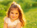 Cute little girl on green field closeup portrait of grass having fun outdoors summer holidays active childhood happiness concept Royalty Free Stock Image