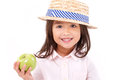 Cute little girl, hand holding green apple Royalty Free Stock Photo