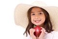 Cute little girl, hand holding red apple