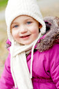 Cute little girl with hat and scarf in autumn winter Royalty Free Stock Photo