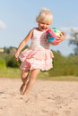 Cute little girl having fun on beach with ball Stock Photography