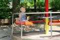 Cute little girl having fun at playground happy child smiling blonde toddler in casual outfit on a riding merry go round enjoying Stock Photography