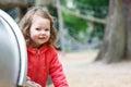 Cute little girl having fun on playground in summer park Stock Image