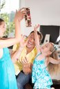 Cute little girl having fun with presents family sideview portrait and packs beautiful blonde mom lifting laughing Royalty Free Stock Image