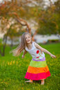 Cute little girl having fun in summer park Stock Image