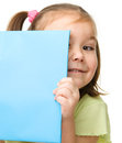 Cute little girl is hiding behind a book Royalty Free Stock Photography
