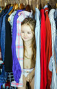 Cute little girl hiding inside wardrobe from her parents early morning Royalty Free Stock Image
