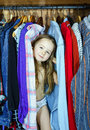 Cute little girl hiding inside wardrobe from her parents early morning Royalty Free Stock Photography