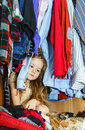 Cute little girl hiding inside wardrobe from her parents Stock Photo
