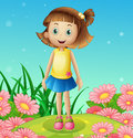 A cute little girl at the hilltop surrounded with flowers illustration of Stock Photos