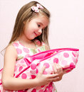 Cute little girl holding her doll Royalty Free Stock Photo