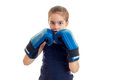 Cute little girl holding a near person hands in boxing gloves is isolated on a white background