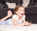 Cute little girl holding a remote control Stock Images