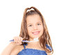 Cute little girl holding a toothbrush isolated on white background Royalty Free Stock Photography