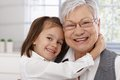 Cute little girl hugging grandmother Stock Photos