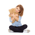 Cute little girl hugging teddy bear childhood toys and shopping concept Stock Photo