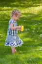 Cute little girl makes soap bubbles Stock Photo
