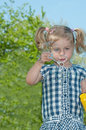 Cute little girl makes soap bubbles Royalty Free Stock Photography