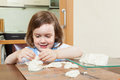 Cute little girl making dough figurines