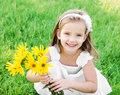 Cute little girl on the meadow with flower in summer day Royalty Free Stock Image