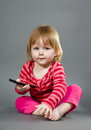 Cute little girl with mobile phone Stock Photos