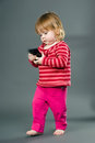 Cute little girl with mobile phone Stock Photography