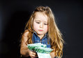 Cute little girl with money euro in her hand business concept how much it costs to be happy Royalty Free Stock Images