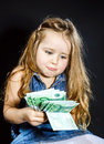 Cute little girl with money euro in her hand business concept how much it costs to be happy Stock Image