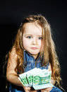 Cute little girl with money euro in her hand business concept how much it costs to be happy Stock Photography