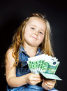 Cute little girl with money euro in her hand business concept how much it costs to be happy Royalty Free Stock Photos