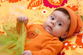 Cute little girl in orange clothes Royalty Free Stock Images
